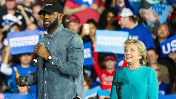 Cleveland Cavaliers star LeBron James speaks as Democratic presidential candidate Hillary Clinton listens during a campaign stop at Cleveland Public Hall in Cleveland, Sunday, Nov. 6, 2016. (AP)