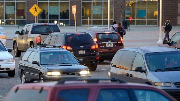 PHOTO: Cars drive through the parking lot at the entrance to a high school in Longmont, Colo., Dec. 4, 2014. (MediaNews Group via Getty Images, FILE)