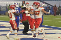 Kansas City Chiefs' Travis Kelce (87), right, celebrates a touchdown during the first half of an NFL football game against the Buffalo Bills, Monday, Oct. 19, 2020, in Orchard Park, N.Y. (AP Photo/Adrian Kraus)