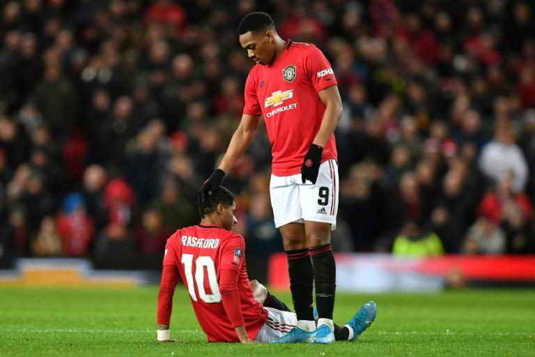Painful cameo: Marcus Rashford was forced off after just 15 minutes as a second half substitute
