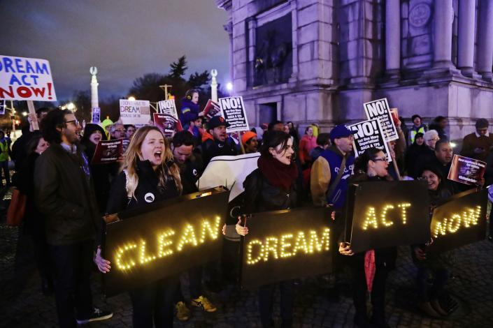 <p>Protestors gather at Grand Army Plaza near the home of Sen. Charles Schumer, D-N.Y Tuesday, Jan. 23, 2018, in New York. (Photo: Frank Franklin II/AP) </p>