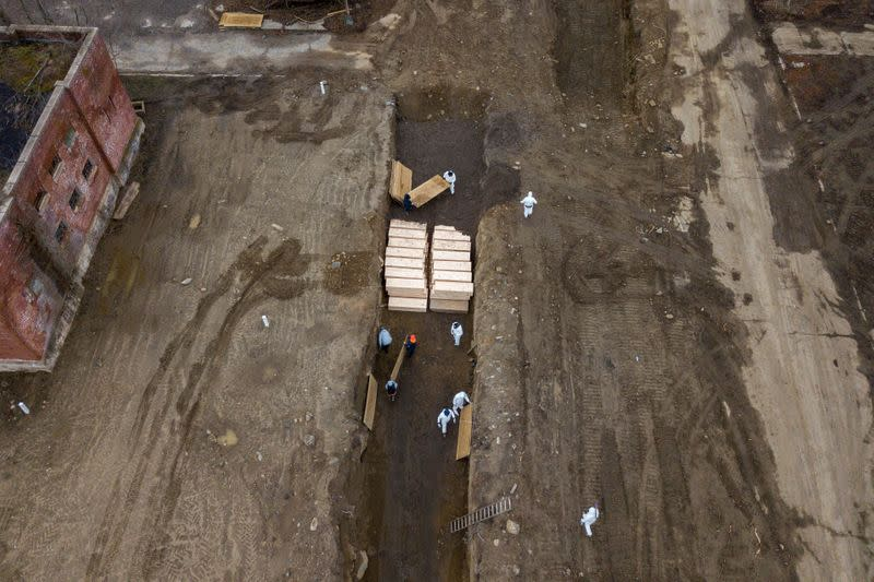 FILE PHOTO: Drone pictures show bodies being buried on New York's Hart Island amid the coronavirus disease (COVID-19) outbreak in New York City