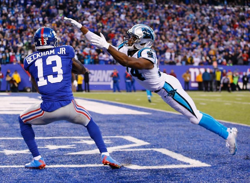 Odell Beckham (L) of the New York Giants and Josh Norman of the Carolina Panthers (R) fought a brutal pitched battle last season (AFP Photo/Al Bello)