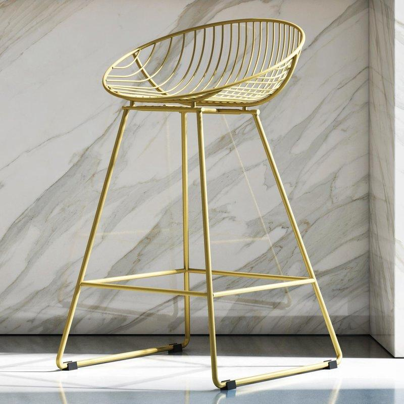 """<p><strong>CosmoLiving by Cosmopolitan</strong></p><p>wayfair.com</p><p><strong>$90.99</strong></p><p><a href=""""https://www.wayfair.com/furniture/pdp/ellis-245-bar-stool-cogl1052.html"""" target=""""_blank"""">BUY NOW</a></p><p>Go for a gilded look with these brushed brass gold bar stools-or keep it simple in black or gray. </p>"""