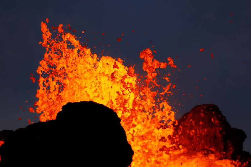 Lava from the Kilauea volcano shoots out of a fissure, in the Leilani Estates near Pahoa, Hawaii, U.S., May 26, 2018.  REUTERS/Marco Garcia