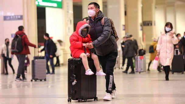 PHOTO: Commuters wearing face masks walk in a railway station in Wuhan, in China's central Hubei province, Jan. 21, 2020. Countries in Asia have ramped up measures to block the spread of a new virus as the death toll in China rose to six. (AFP via Getty Images)