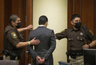 Victor Hugo Cuevas, a 26-year-old linked to a missing tiger named India, is taken into custody after his bond in a separate murder charge was revoked and reset at $300,000 at Fort Bend County Justice Center on Friday, May 14, 2021, in Richmond, Texas. (Godofredo A. Vásquez/Houston Chronicle via AP)