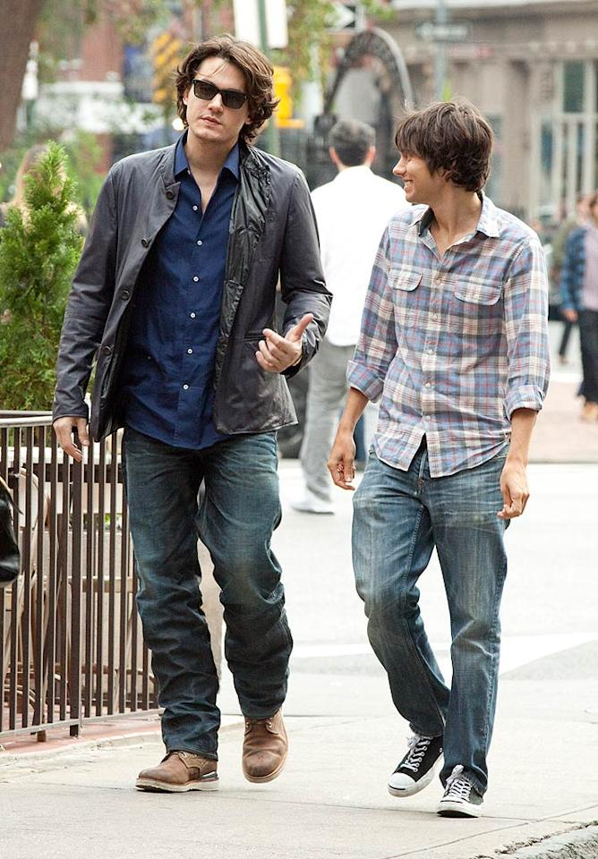 """Music man John Mayer took a Sunday stroll in NYC's Greenwich Village. For once, the 33-year-old, who's been linked to Jennifer Love Hewitt, Jessica Simpson, Jennifer Aniston, and even his """"Half of My Heart"""" co-singer Taylor Swift (!), was accompanied by a guy. Janet Mayer/<a href=""""http://www.splashnewsonline.com"""" target=""""new"""">Splash News</a> - October 24, 2010"""