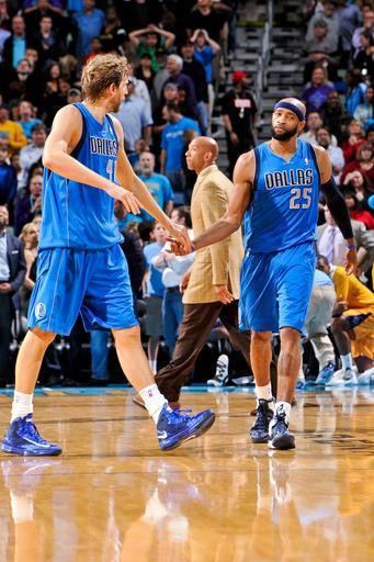 NEW ORLEANS, LA - FEBRUARY 22: Vince Carter #25 of the Dallas Mavericks celebrates with teammate Dirk Nowitzki #41 after making a three-pointer against the New Orleans Hornets on February 22, 2013 at the New Orleans Arena in New Orleans, Louisiana. (Photo by Bill Baptist/NBAE via Getty Images)