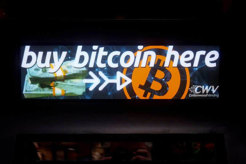 FILE PHOTO: A Bitcoin ATM sign is pictured in a bodega in New York
