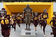 Arizona State Sun Devils players run past the Pat Tillman statue before the college football game against the Oregon Ducks at Sun Devil Stadium on September 23, 2017 in Tempe, Arizona. (Photo by Christian Petersen/Getty Images)