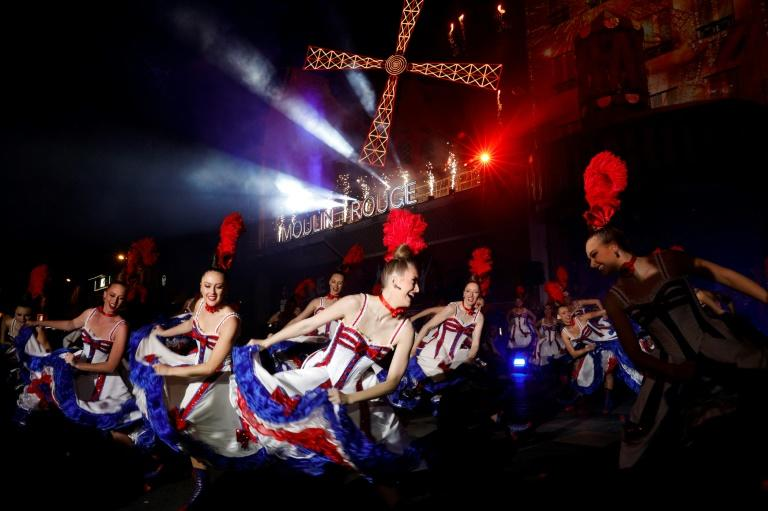 Moulin Rouge dancers performed outside the Paris cabaret to mark its 130th anniversary on Sunday