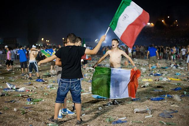 ROME, ITALY - JULY 01: Italian fans react after the defaet at the UEFA EURO 2012 final match between Italy and Spain on a big screen at the Circus Maximo on July 1, 2012 in Rome, Italy. (Photo by Giorgio Cosulich/Getty Images)