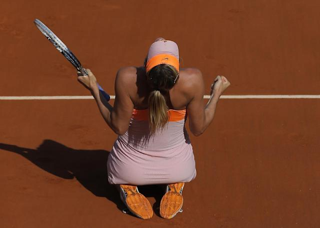 Russia's Maria Sharapova reacts as she defeats Romania's Simona Halep during their final match of the French Open tennis tournament at the Roland Garros stadium, in Paris, France, Saturday, June 7, 2014. Sharapova won 6-4, 6-7, 6-4. (AP Photo/Michel Spingler)