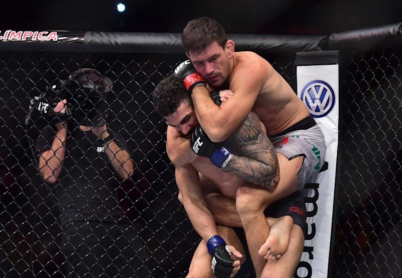 Feb 2, 2019; Fortaleza, Brazil; Demian Maia (red gloves) fights Lyman Good (blue gloves) during UFC Fight Night at Arena CFO. Mandatory Credit: Jason Silva-USA TODAY Sports