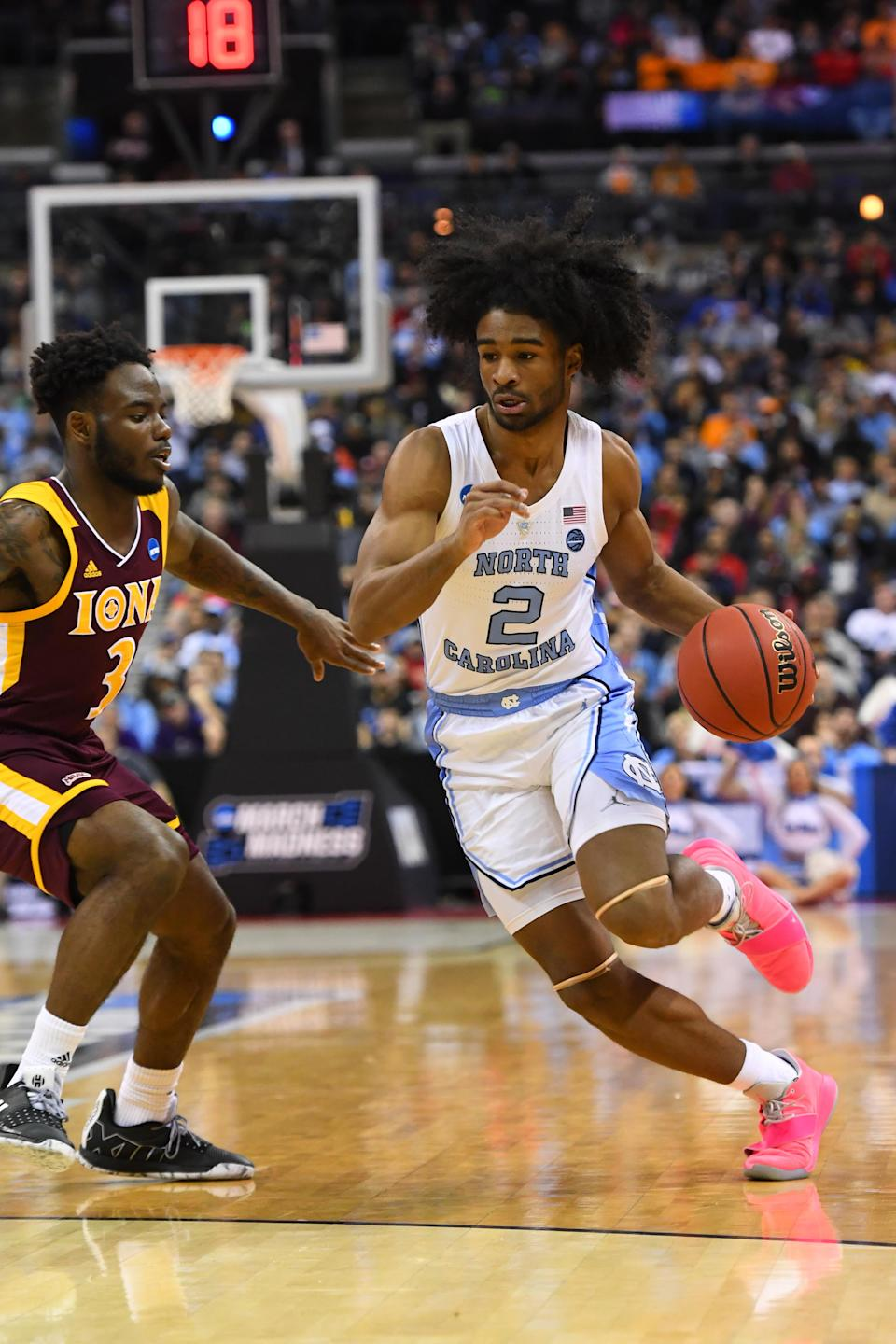 <p>Coby White #2 of the North Carolina Tar Heels drives to the basket against Asante Gist #3 of the Iona Gaels in the first round of the 2019 NCAA Men's Basketball Tournament held at Nationwide Arena on March 22, 2019 in Columbus, Ohio. (Photo by Jamie Schwaberow/NCAA Photos via Getty Images) </p>
