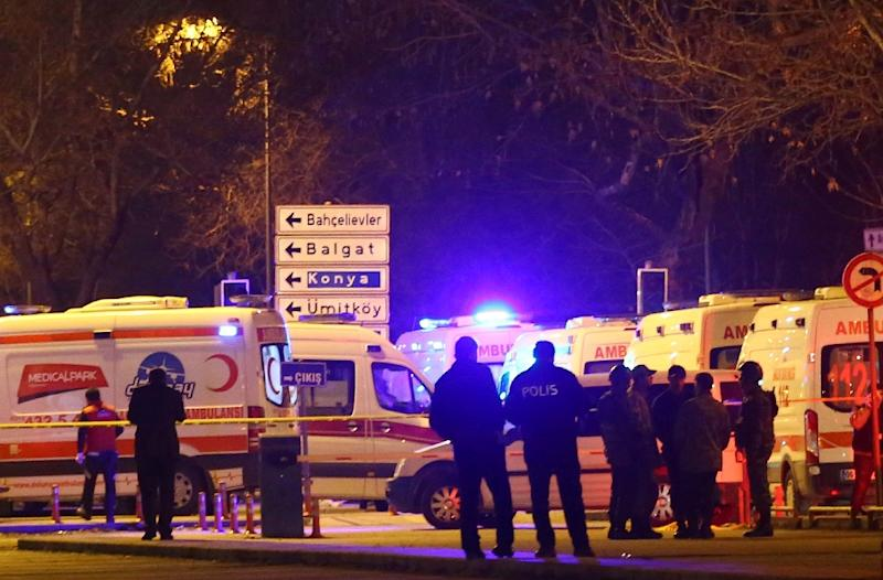 Turkish police and ambulance cars are seen near the site of an explosion after an attack targeted a convoy of military service vehicles in Ankara on February 17, 2016 (AFP Photo/Adem Altan)