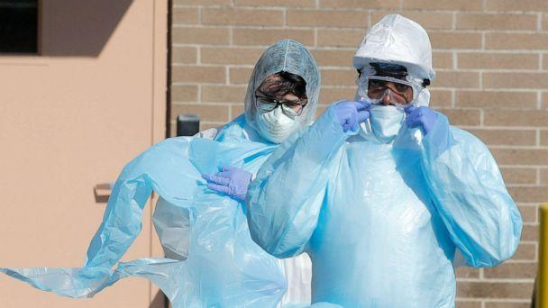 PHOTO: Healthcare workers walk in personal protective equipment outside the Wyckoff Heights Medical Center during the outbreak of the coronavirus disease (COVID-19) in Brooklyn, New York, April 6, 2020. (Brendan Mcdermid/Reuters)