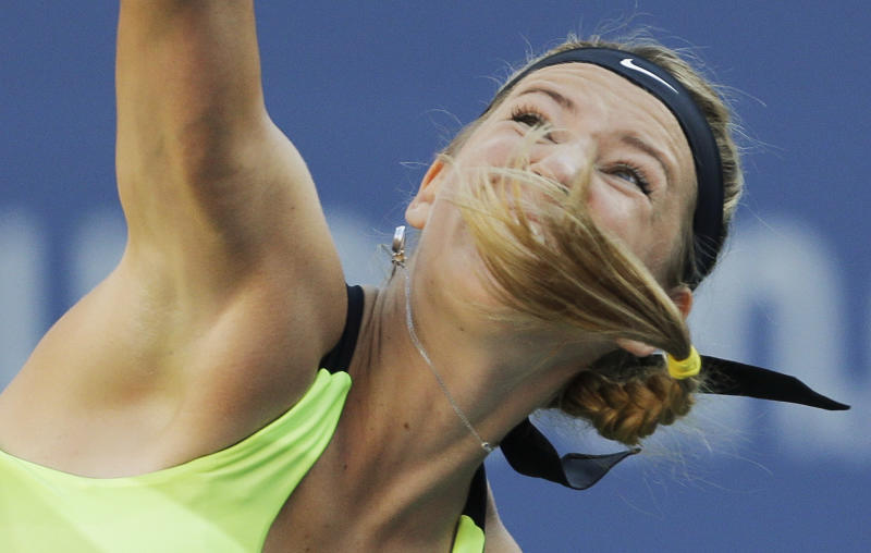 Victoria Azarenka, of Belarus, serves to Serena Williams during the championship match at the 2012 US Open tennis tournament, Sunday, Sept. 9, 2012, in New York. (AP Photo/Mike Groll)