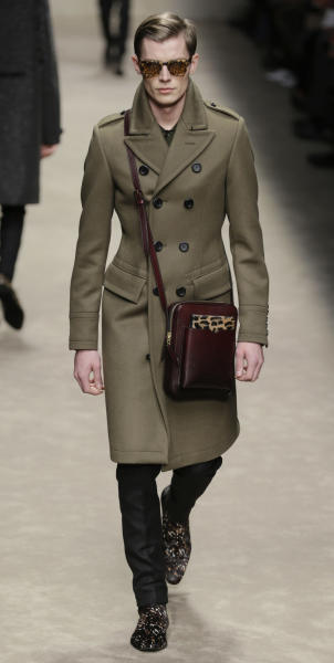 A model wears a creation of Burberry Prorsum men's Fall-Winter 2013-14 collection, part of the Milan Fashion Week, unveiled in Milan, Italy, Saturday, Jan. 12, 2013.(AP Photo/Luca Bruno)