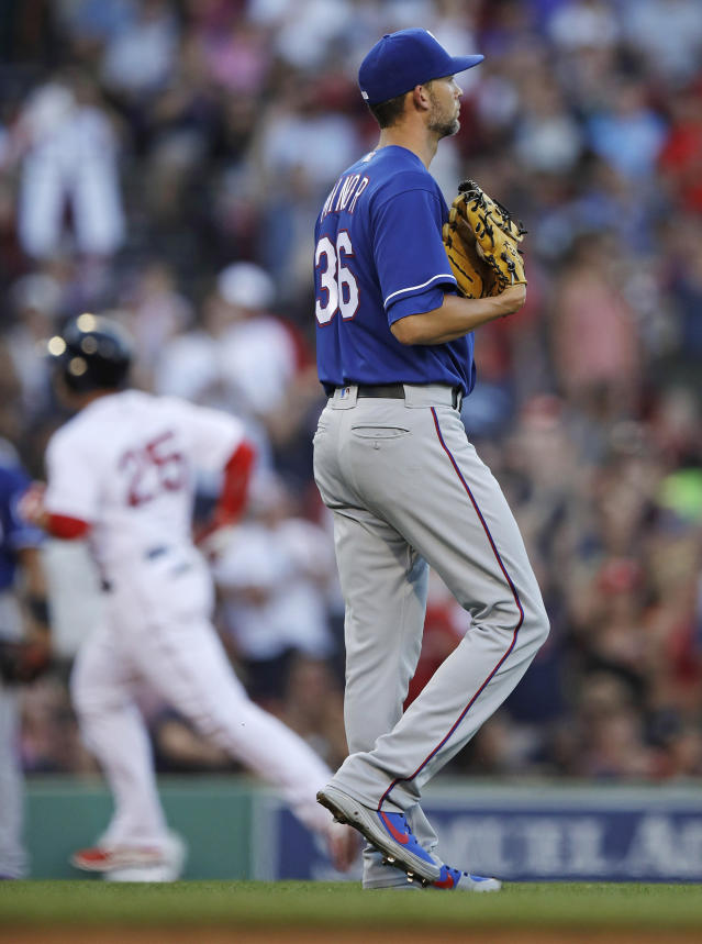 Texas Rangers starting pitcher Mike Minor walks away from the mound as Boston Red Sox's Steve Pearce rounds the bases on a two run home run during the first inning of a baseball game at Fenway Park in Boston, Monday, July 9, 2018. (AP Photo/Charles Krupa)