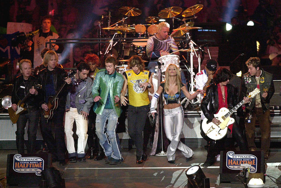 Britney Spears, fourth from right, and Lance Bass, right, perform during the halftime show at the 2001 Super Bowl. (Photo: Doug Pensinger/ALLSPORT)