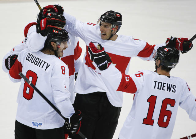 Team Canada celebrates a third period goal against Latvia during a men's quarterfinal ice hockey game at the 2014 Winter Olympics, Wednesday, Feb. 19, 2014, in Sochi, Russia. (AP Photo/Mark Humphrey)