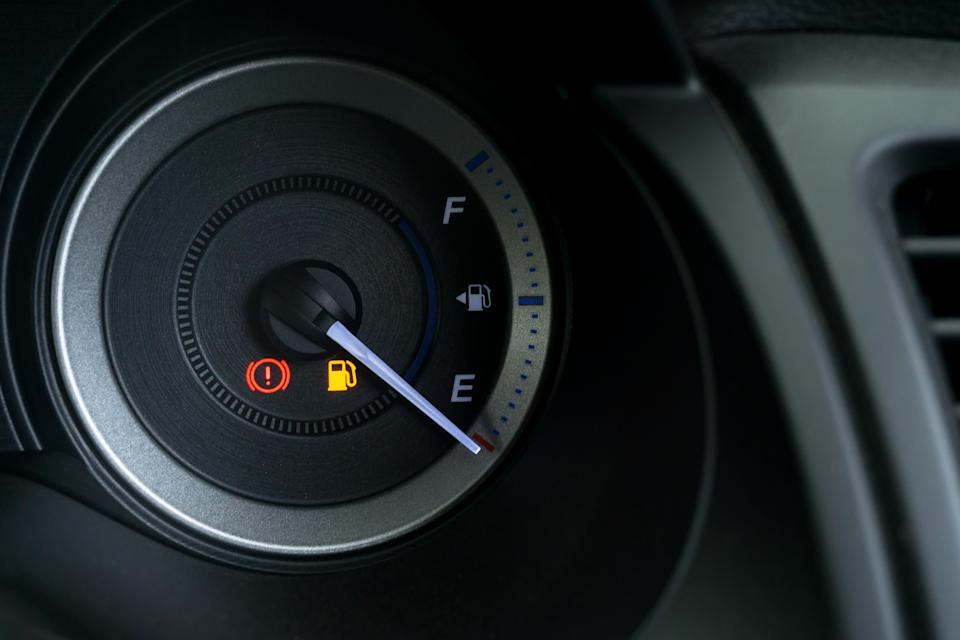 Detail with the fuel gauges showing and empty tank on dashboard of car