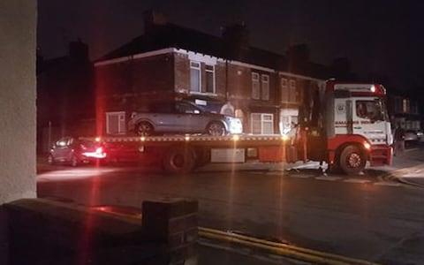 The silver Astra being taken away - Credit: MEN Media/Hull Daily Mail
