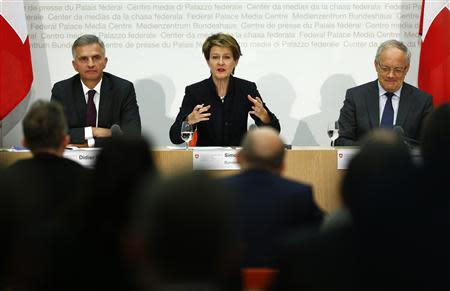 Swiss Foreign Minister Didier Burkhalter (L-R), Justice Minister Simonetta Sommaruga and Economy Minister Johann Schneider-Ammann attend a news conference on the 'Mass Immigration' initiative in Bern November 25, 2013. REUTERS/Ruben Sprich