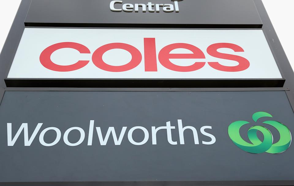 Coles and Woolworths on signs. Source: Getty Images