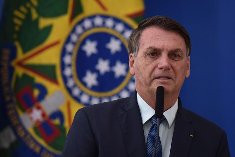 Brazilian President Jair Bolsonaro speaks during the swearing-in ceremony of his new health minister, Nelson Teich, at Planalto Palace in Brasilia on April 17, 2020. (Photo: AP Photo/Andre Borges)