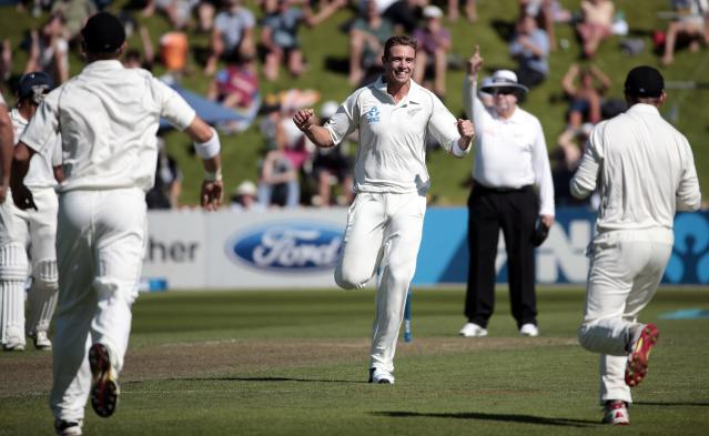 New Zealand's Tim Southee celebrates taking the wicket of India's Murali Vijay during the first innings on day one of the second international test cricket match at the Basin Reserve in Wellington, February 14, 2014. REUTERS/Anthony Phelps (NEW ZEALAND - Tags: SPORT CRICKET)