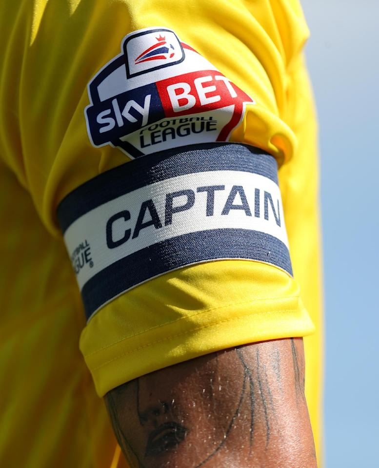 A close up detail of the new Sky Bet sponsorship on the arm of Coventry City's captain Carl Baker during the Sky Bet League One match at Broadfield Stadium, Crawley.