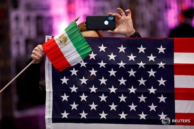 FILE PHOTO: Attendees hold flags from Iran and the United States as Iranian Americans from across California converge in Los Angeles to participate in the California Convention for a Free Iran and to express support for nationwide protests in Iran