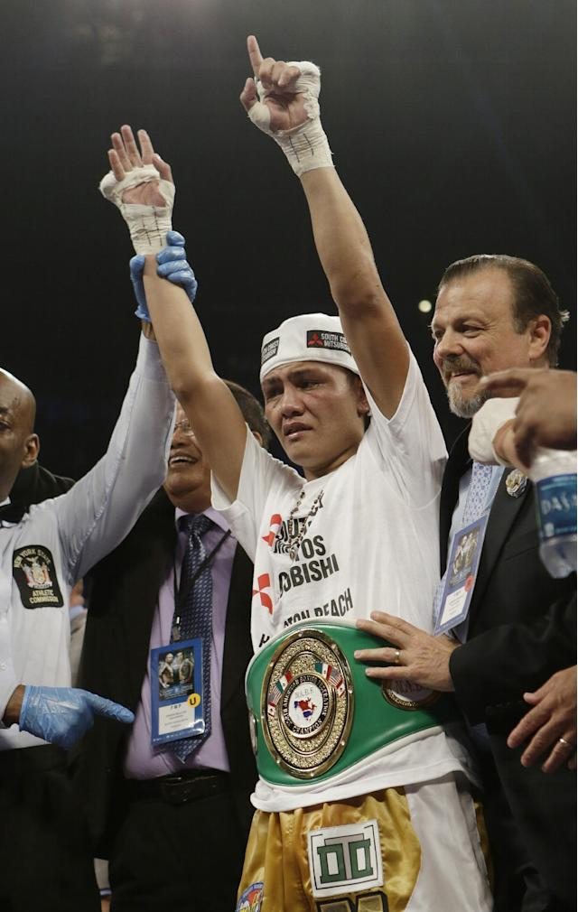 Marvin Sonsona, of the Philippines, celebrates after winning a NABF Featherweight Title boxing match against Wilfredo Vazquez, of Puerto Rico, Saturday, June 7, 2014, in New York. Sonsoma won the fight by split decision. (AP Photo/Frank Franklin II)