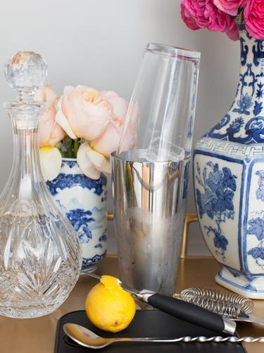 """<div class=""""caption-credit"""">Photo by: Stephanie Stanley</div><div class=""""caption-title"""">Bar ware</div>To mix a proper cocktail--and add some fun shaken-not-stirred sound effects to the evening--invest in a Boston Shaker set, which has a mixing tin and glass that form an airtight lock and can be properly shaken over your shoulder. Beyond that, you really only need a mixing spoon, strainer, and paring knife for garnishes, but a plastic cutting board can also be handy in keeping the bar cart from getting too wet. <ul> <li> <b><a rel=""""nofollow noopener"""" href=""""http://www.redbookmag.com/recipes-home/tips-advice/party-food-recipes?link=relt&dom=yah_life&src=syn&con=blog_redbook&mag=rbk"""" target=""""_blank"""" data-ylk=""""slk:The 30 Best Party Foods of All Time"""" class=""""link rapid-noclick-resp"""">The 30 Best Party Foods of All Time</a></b> </li> <li> <a rel=""""nofollow noopener"""" href=""""http://www.redbookmag.com/recipes-home/tips-advice/classic-cocktails?link=relt&dom=yah_life&src=syn&con=blog_redbook&mag=rbk"""" target=""""_blank"""" data-ylk=""""slk:6 Classic Cocktails to Sip Now"""" class=""""link rapid-noclick-resp""""><b>6 Classic Cocktails to Sip Now</b></a> </li> </ul>"""