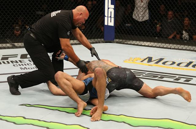 Rafael Dos Anjos was able to finish with a submission hold in the fourth round after wearing Kevin Lee down. (Getty Images)