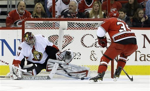 Ottawa Senators goalie Craig Anderson deflects a shot on goal by Carolina Hurricanes' Patrick Dwyer (39) during the first period of an NHL hockey game in Raleigh, N.C., Friday, Feb. 1, 2013. (AP Photo/Gerry Broome)