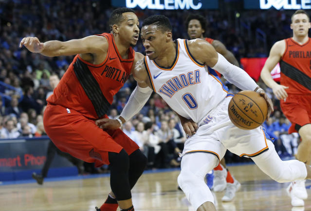 Oklahoma City Thunder guard Russell Westbrook (0) drives around Portland Trail Blazers guard C.J. McCollum during the first quarter of an NBA basketball game in Oklahoma City, Tuesday, Jan. 9, 2018. (AP Photo/Sue Ogrocki)