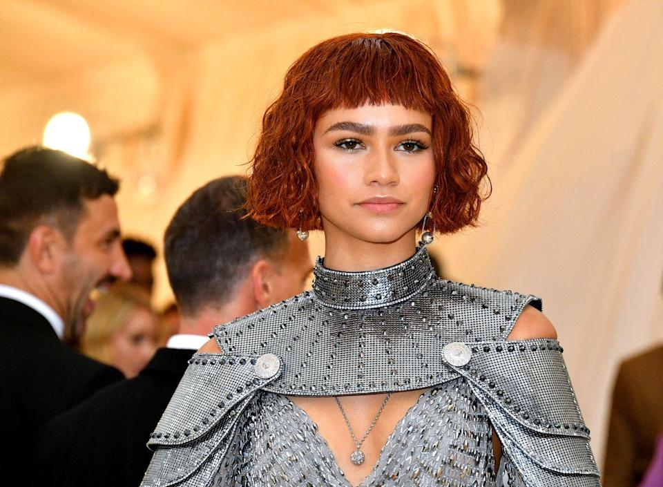 <p>Zendaya's red, wavy, wet-styled bob popped against dark brows and pale pink cheeks and lips.</p>
