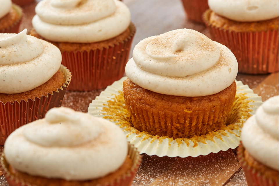 """<p>This easy cupcake is full of pumpkin spice and topped with a simple cream cheese frosting. </p><p>Get the recipe from <a href=""""https://www.delish.com/cooking/recipe-ideas/a28438880/easy-pumpkin-spice-cupcakes-recipe/"""" rel=""""nofollow noopener"""" target=""""_blank"""" data-ylk=""""slk:Delish"""" class=""""link rapid-noclick-resp"""">Delish</a>.</p>"""