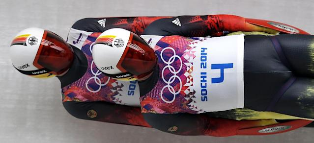 The doubles team of Tobias Arlt and Tobias Wendl of Germany speed down the track in their final run during the men's doubles luge at the 2014 Winter Olympics, Wednesday, Feb. 12, 2014, in Krasnaya Polyana, Russia. (AP Photo/Michael Sohn)