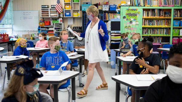 PHOTO: Columbia Elementary School 4th grade reading and language arts teacher Danielle Whittington works with students on Aug. 25, 2020 in Columbia, Miss. (Edmund D. Fountain for The Washington Post via Getty Images, FILE)