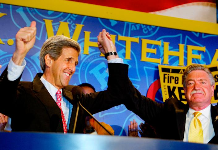 Democratic presidential candidate U.S. Senator John Kerry (D-MA) (L), is introduced by the International Association of Fire Fighters General President Harold Schaitberger before speaking at their meeting in Washington, March 15, 2004. Schaitberger endorsed Kerry for president at the meeting. REUTERS/Larry Downing US ELECTION  LSD