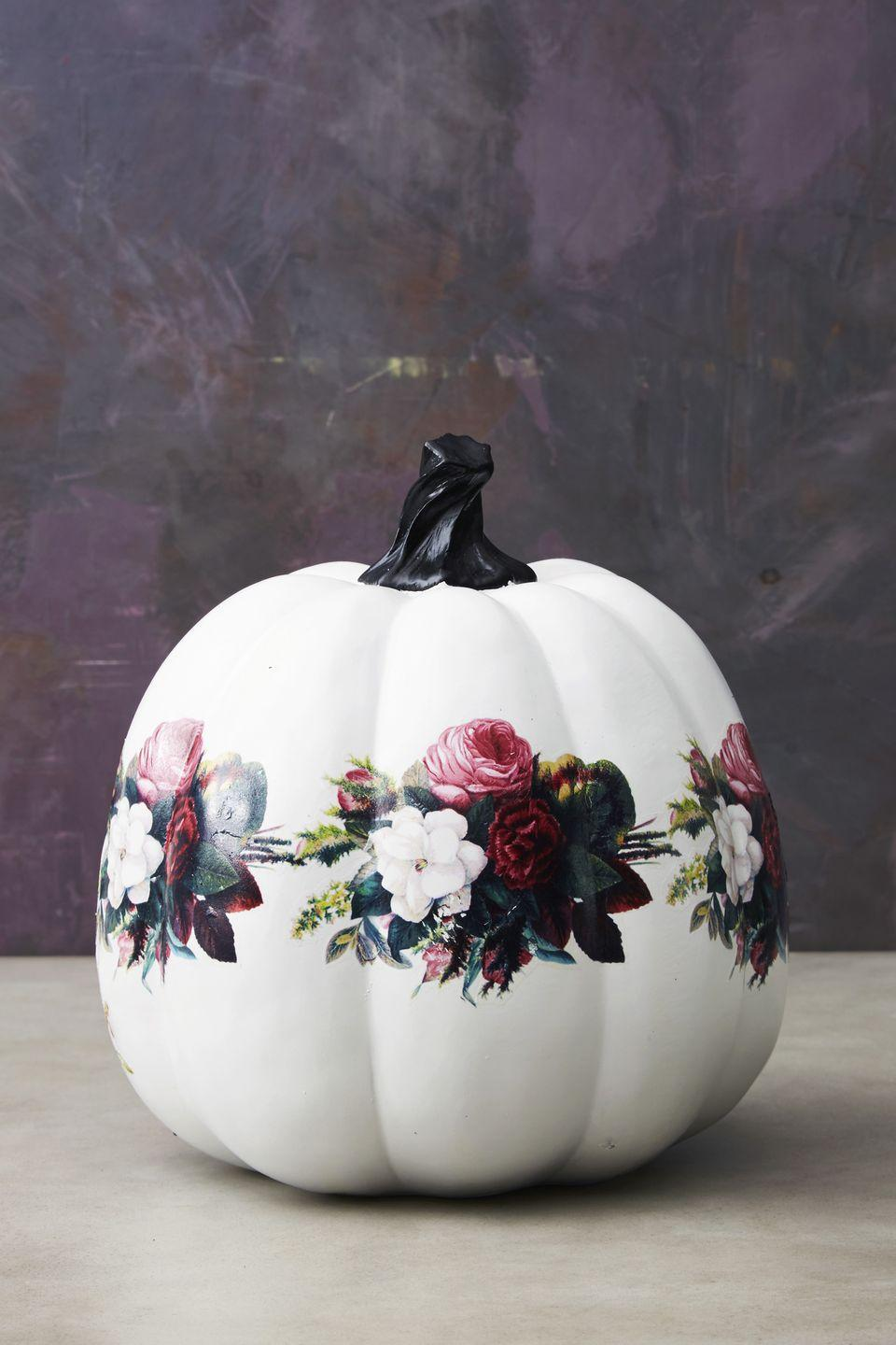 """<p>No intricate (ahem, complicated) painting here. After painting the pumpkin white, adhere temporary tattoos on the pumpkin, just as you would on skin. For a botanical look, connect a ring of floral tattoos around the middle. </p><p><a class=""""link rapid-noclick-resp"""" href=""""https://www.amazon.com/ULTNICE-Temporary-Tattoos-Stickers-Blossoms/dp/B072F5WDC8/?tag=syn-yahoo-20&ascsubtag=%5Bartid%7C10055.g.2592%5Bsrc%7Cyahoo-us"""" rel=""""nofollow noopener"""" target=""""_blank"""" data-ylk=""""slk:SHOP FLOWER TATTOOS"""">SHOP FLOWER TATTOOS</a></p>"""