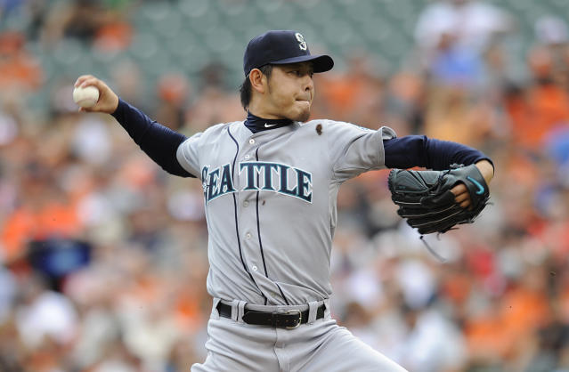 Seattle Mariners starting pitcher Hisashi Iwakuma delivers against the Baltimore Orioles in the first inning of a baseball game Sunday, Aug. 3, 2014, in Baltimore.(AP Photo/Gail Burton)