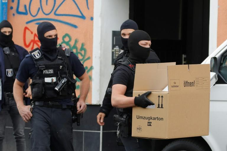 German police carried out dawn raids against mosques and associations in Berlin and other cities on Thursday as it tightened its ban on the activities of Lebanese Shiite militant group Hezbollah