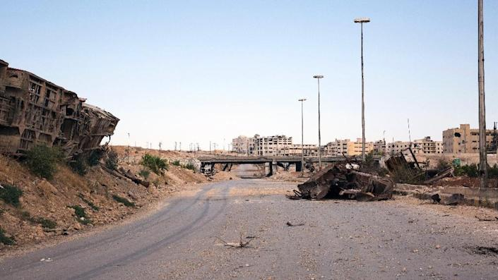 The rubble-strewn Castello Road, the main route for humanitarian assistance in to divided Syrian city of Aleppo (AFP Photo/Karam Al-Masri)