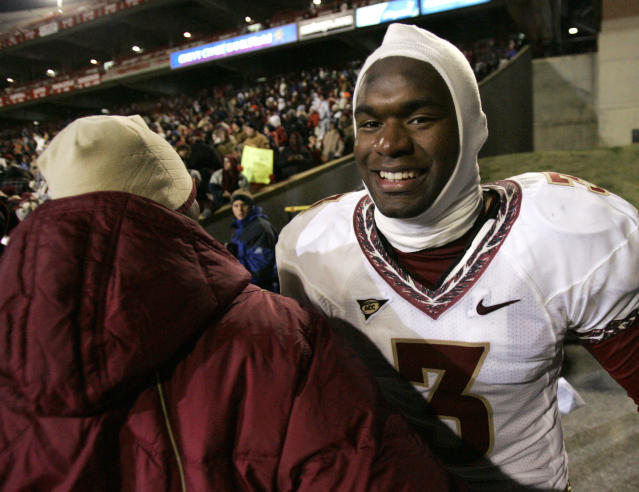 Florida State safety Myron Rolle is congratulated after the Seminoles defeated Maryland 37-3 in a 2008 game. (AP Photo/Rob Carr)